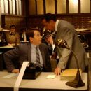 Matthew Broderick as nebbish accountant Leo Bloom and Jon Lovitz as his cruel boss Mr. Marks.