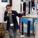 """Charlie (TYLER JAMES WILLIAMS) rocks out in a gadget store in Warner Bros. Pictures' and Village Roadshow Pictures' comedy """"Unaccompanied Minors,"""" distributed by Warner Bros. Pictures. Photo by John Bramley"""