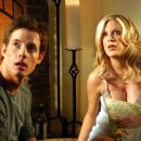 Matt (Philipp Karner) and Alex (Tori Spelling) in C. Jay Cox comedy romance 'Kiss the Bride.'