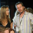 (L-r) JENNIFER ANISTON with director KEN KWAPIS on the set of New Line Cinema's romantic comedy 'He's Just Not That Into You,' a Warner Bros. Pictures release. Photo by Darren Michaels