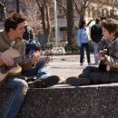 """JONATHAN RHYS MEYERS stars as Louis Connelly and FREDDIE HIGHMORE stars as August Rush in Warner Bros. Pictures' music-driven drama """"August Rush."""" The film also stars Keri Russell, Terrence Howard and Robin Williams. Photo by Abbot Gense"""