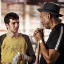 Jay Baruchel as Danger Barch and Morgan Freeman as Scrap in Warner Bros. Pictures' drama Million Dollar Baby. The Malpaso production also stars Clint Eastwood and Hilary Swank. Merie W. Wallace