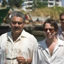(l to r) General Modrano (JOAQUIN COSIO), Dominic Greene (MATHIEU AMALRIC) and Elvis (ANATOLE TAUBMAN) discuss business at the Kings Quay, Haiti. Location: Colon, Panama. Photo By: Karen Ballard. Quantum of Solace © 2008 Danjaq, LLC, United Artists Corpor - 454 x 303