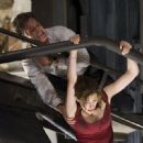Kurt Russell as Robert Ramsey and Jacinda Barrett as Maggie James in director Wolfgang Petersen, a Poseidon - 2006
