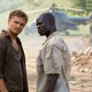 LEONARDO DiCAPRIO stars as Danny Archer and DJIMON HOUNSOU stars as Solomon Vandy in Warner Bros. Pictures' and Virtual Studios' action drama 'Blood Diamond,' distributed by Warner Bros. Pictures. Photo by Jaap Buitendijk