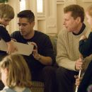 "Jimmy Egan (COLIN FARRELL, middle left), Francis Tierney, Jr. (NOAH EMMERICH, middle right) share the holiday with their children (TY SIMPKINS, left, and RYAN SIMPKINS, right), in New Line Cinema's crime drama ""Pride and Glory,"" distribu"