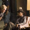 Director Ridley Scott and Denzel Washington on the set of American Gangster.
