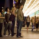 In Columbia Pictures' 21, the M.I.T. blackjack team - a group of students that has figured out how to take Vegas for millions - prepares to hit the tables.  Left to right: Kianna (Liza Lapira), Choi (Aaron Yoo), Jill Taylor (Kate Bosworth), Ben Camp - 454 x 303