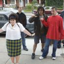 Director Adam Shankman (center right) reviews a scene with Nikki Blonsky (front left), 1st Assistant Director Daniel Silverberg (rear left), Director of Photography Bojan Bazelli (center) and Executive Producer Garrett Grant on the set of New Line Cinema&