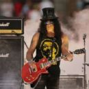 Slash performs on stage before the 2014 NRL Grand Final match between the South Sydney Rabbitohs and the Canterbury Bulldogs at ANZ Stadium on October 5, 2014 in Sydney, Australia