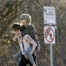 Taylor Swift gets cozy with a tattooed boy on the set of her new music video, filming on location in Los Angeles
