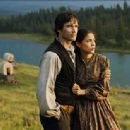 Matthew Settle as Jacob Wheeler and Tonantzin Carmelo as Thunder Heart Woman in Robert Dornhelm's INTO THE WEST, Turner Network Television release. © 2005 - 401 x 314