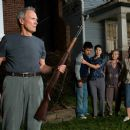 (L-r) Walt Kowalski (CLINT EASTWOOD), Thao (BEE VANG), Vu (BROOKE CHIA THAO), Grandma (CHEE THAO) and Sue (AHNEY HER) in Warner Bros. Pictures' and Village Roadshow Pictures' drama 'Gran Torino,' distributed by Warner Bros. Pictures. Photo - 454 x 369