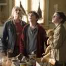 "(Left to right) Mallory (SARAH BOLGER) and her brothers Jared and Simon (both FREDDIE HIGHMORE) hear strange noises after they move into their great-great-uncle Arthur Spiderwick's secluded old house in ""The Spiderwick Chronicles."" Photo - 454 x 303"
