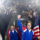 The members of Team USA enter Beerfest Arena. Pictured are: STEVE LEMME as Fink (with flag), PAUL SOTER as Jan Wolfhouse, KEVIN HEFFERNAN as Landfill and JAY CHANDRASEKHAR as Barry in Warner Bros. Pictures' and Legendary Pictures' comedy &#822