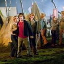 (L - r)Emma Watson as Hermione Granger, Daniel Radcliffe as Harry Potter and Rupert Grint as Ron Weasley in Warner Bros. Pictures' fantasy 'Harry Potter and the Goblet of Fire' - 2005