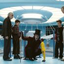 L-r: DAVID KELLY as Grandpa Joe; FREDDIE HIGHMORE as Charlie Bucket; JOHNNY DEPP as Willy Wonka; DEEP ROY as the Oompa-Loompa; JORDAN FRY as Mike Teavee and ADAM GODLEY as Mr. Teavee in Warner Bros. Pictures' fantasy adventure 'Charlie and the - 454 x 245