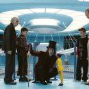 L-r: DAVID KELLY as Grandpa Joe; FREDDIE HIGHMORE as Charlie Bucket; JOHNNY DEPP as Willy Wonka; DEEP ROY as the Oompa-Loompa; JORDAN FRY as Mike Teavee and ADAM GODLEY as Mr. Teavee in Warner Bros. Pictures' fantasy adventure 'Charlie and the