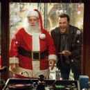 "PAUL GIAMATTI stars as Nick ""Santa"" Claus and VINCE VAUGHN stars as Fred Claus in Warner Bros. Pictures' holiday comedy ""Fred Claus,"" distributed by Warner Bros. Pictures. Photo by Jaap Buitendijk."