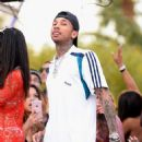 Tyga performs during DAYLIGHT Beach Club's grand opening weekend at the Mandalay Bay Resort and Casino on March 26, 2017 in Las Vegas, Nevada - 454 x 466
