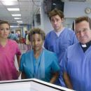 "(L-r) MANDY MOORE as Sadie Jones, WANDA SYKES as Nurse Borman, JOHN KRASINSKI as Ben Murphy and ROBIN WILLIAMS as Reverend Frank in Warner Bros. Pictures' and Village Roadshow Pictures' comedy ""License to Wed,"" distributed by Warne"