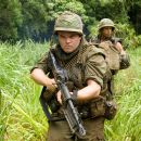 """Jeff Portnoy (Jack Black, left) and Tugg Speedman (Ben Stiller, right) are two of the stars of a war movie who get caught up in a real battle in the action comedy """"Tropic Thunder."""" Credit: Merie Weismiller Wallace. ©2008 DreamWorks LLC. All Ri"""