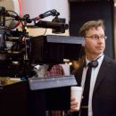 "Director PAUL FEIG observes a scene from ""Unaccompanied Minors,"" a Warner Bros. Pictures' and Village Roadshow Pictures' comedy distributed by Warner Bros. Pictures. Photo by John Bramley"
