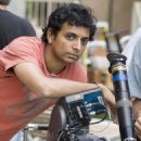 "Director M. NIGHT SHYAMALAN on the set Warner Bros. Pictures' and Legendary Pictures' ""Lady In The Water,"" distributed by Warner Bros. Pictures. The film stars Paul Giamatti and Bryce Dallas Howard. Photo by Frank Masi"