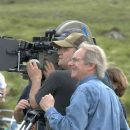 Ken Loach, director and Carl Hudson, focus puller on the set of THE WIND THAT SHAKES THE BARLEY directed by Ken Loach. Photo credit: Joss Barratt. An IFC First Take release. - 454 x 681