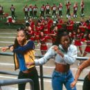 The East Compton Clovers - Jenelope (Natina Reed), LaFred (Brandi Williams), Isis (Gabrielle Union) and Lava (Shamari Fears) - bust some moves in front of the Rancho Carne Toros in Universal's Bring It On - 2000 - 400 x 268
