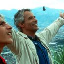 Anderson Ballesteros as Alexis and German Jaramillo as Fernando standing over Medellin, Colombia, in Paramount Classics' Our Lady of The Assassins - 2001 - 400 x 226