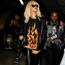 Rihanna wears a very short dress with flames on it as she races to Waterloo Station to catch a train to see Drake in concert