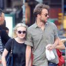 A smitten looking Dakota Fanning and her boyfriend Jamie Strachan go hand in hand for a stroll around New York City - 443 x 594