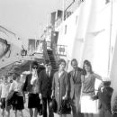 July 29th, 1963 - The Rt Hon Sir David Ormsby-Gore KCMG went aboard the Queen Mary on her arrival today at Southhampton with his children Julian (22, dark glasses), Jane (20) and Victoria (16) to meet his wife Lady Ormsby-Gore, daughter Alice (11, with co - 454 x 378
