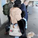 Vanessa Hudgens and Austin Butler at LAX Airport in LA - 454 x 623