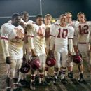 The triumphant T.C. Williams High School team, the Titans, includes (from left to right) 'Blue' Stanton (Earl C. Poitier), Julius Campbell (Wood Harris), Petey Jones (Donald Faison), Adam Bosley (Ryan Gosling), Jerry 'Rev' Harris (Craig Ki