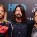 Musicians Taylor Hawkins, Dave Grohl, and Chris Shiflett of The Foo Fighters attend The 'Foo Fighters: Sonic Highways' New York Premiere at Ed Sullivan Theater on October 14, 2014 in New York City.