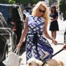 Pamela Anderson – Leaving the George V Hotel in Paris
