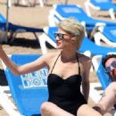 Chloe Jasmine in Black Swimsuit on the beach in Cape Verde - 454 x 653