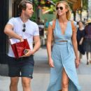 Model Karlie Kloss is all smiles while out and about in New York City, New York with a friend on June 15, 2015