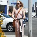 Caity Lotz – Shopping in Style with a Scooter in West Hollywood