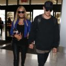 Paris Hilton and Boyfriend at LAX Airport in Los Angeles