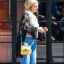 Beverley Mitchell waits for a cab outside The Bowery Hotel in New York City, New York on September 3, 2014 - 350 x 594