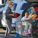 Charlize Theron takes her son Jackson grocery shopping at Whole Foods in Los Angeles, California on December 26, 2014