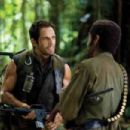 """Tugg Speedman (Ben Stiller, left) and Kirk Lazarus (Robert Downey Jr., right) are shooting an epic war movie and wind up in a real battle in the action comedy """"Tropic Thunder."""" Credit: Merie Weismiller Wallace. ©2008 DreamWorks LLC. All Rights"""