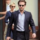Bradley Cooper And Renee Zellweger Leave Their NYC Hotel