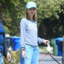 Calista Flockhart with her dogs out in Brentwood - 454 x 755