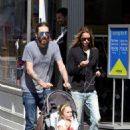 Chris Robinson takes a stroll with wife Allison Bridges and their daughter Cheyenne in New York City
