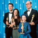 Tom Hanks, Holly Hunter, Anna Paquin and Tommy Lee Jones At The 66th Annual Academy Awards (1994) - Press Room - 454 x 705