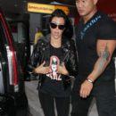 Kourtney Kardashian visits LAX with baby Reign on September 13, 2015